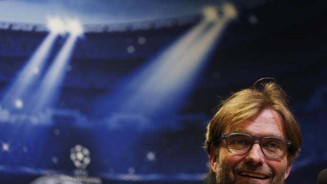 Borussia Dortmund's coach Klopp smiles during a news conference in Dortmund