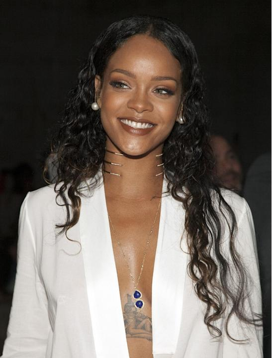 Rihanna attends the Edun Spring/Summer 2015 fashion show at Mercedes-Benz Fashion Week on Sunday, Sept. 7, 2014 in New York. (Photo by Andy Kropa/Invision/AP)