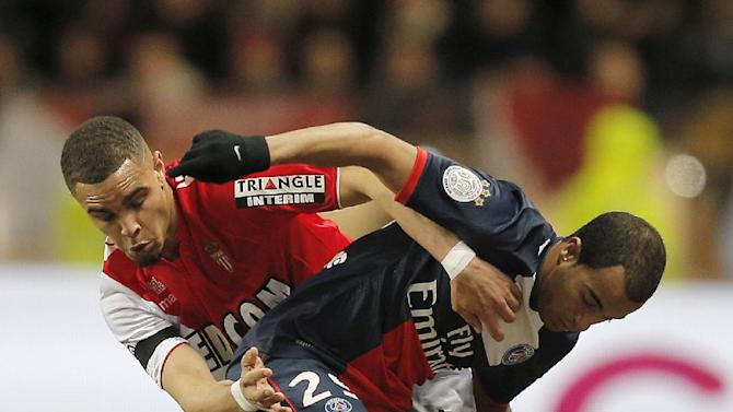 Monaco's Layvin Kurzawa of France, left, challenges for the ball with Paris Saint Germain's Lucas of Brazil during their French League One soccer match, in Monaco stadium, Sunday, Feb. 9 , 2014
