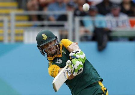 South Africa's Faf du Plessis hits the ball for six runs his Cricket World Cup semi final against New Zealand in Auckland