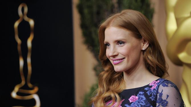 "Jessica Chastain, nominated for best actress in a leading role for ""Zero Dark Thirty,"" arrives at the 85th Academy Awards Nominees Luncheon at the Beverly Hilton Hotel on Monday, Feb. 4, 2013, in Beverly Hills, Calif. (Photo by Chris Pizzello/Invision/AP)"