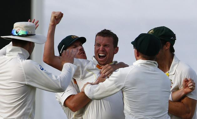 Australia's Siddle celebrates with teammates after taking the wicket of England's Bell during the fourth day of the third Ashes test cricket match at the WACA ground in Perth