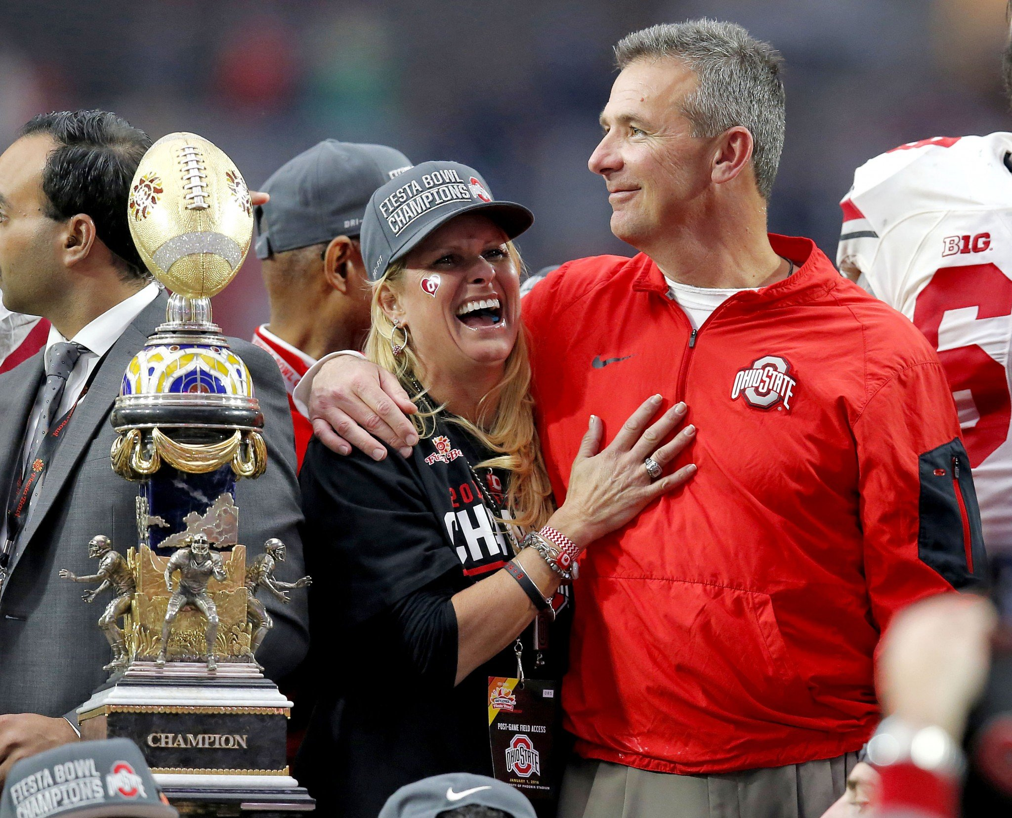 Ohio state head coach urban meyer hugs his wife shelley meyer after