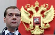 Dmitry Medvedev speaks at the Russian State Duma's extraordinary plenary session. Russia's new President Vladimir Putin on Tuesday won parliamentary approval for his predecessor Medvedev to become prime minister, as protesters tried new tactics to keep up pressure on the Kremlin