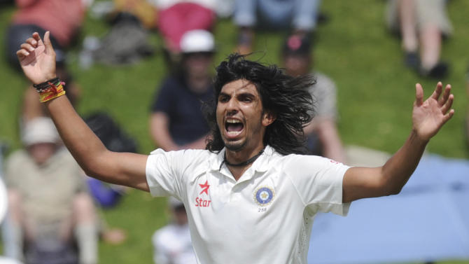 India's Ishant Sharma claims a 5 wicket bag with the dismissal of New Zealand's BJ Watling for 0 on the first day of the second cricket test in Wellington, New Zealand, Friday, Feb. 14, 2014. (AP Photo/SNPA, Ross Setford) NEW ZEALAND OUT
