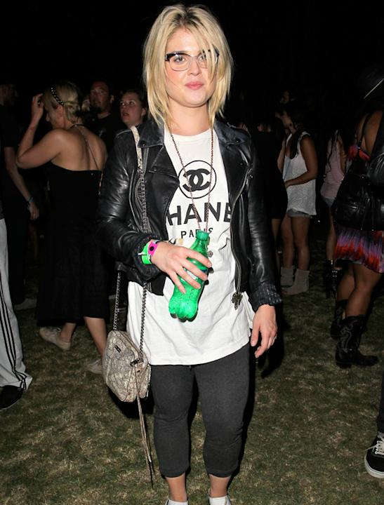 Celebrities at festivals photos: Kelly Osbourne hid her slender frame under a large tee but looked set to party all night long!
