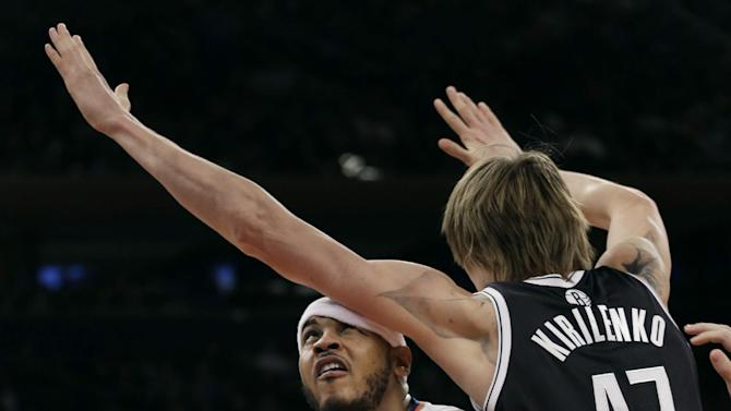 New York Knicks' Carmelo Anthony, left, is fouled by Brooklyn Nets' Andrei Kirilenko during the first half of the NBA basketball game at Madison Square Garden Monday, Jan. 20, 2014, in New York
