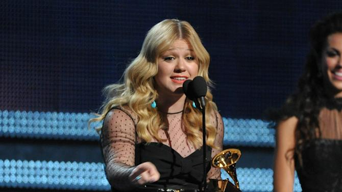 "Kelly Clarkson accepts the award for best pop vocal album for ""Stronger"" at the 55th annual Grammy Awards on Sunday, Feb. 10, 2013, in Los Angeles. (Photo by John Shearer/Invision/AP)"