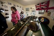 Tourists visit a war museum in San Carlos village in the Falkland Islands, on March 25, 2012. Britain and Argentina on Monday marked 30 years since the invasion of the Falkland Islands triggered a 74-day war, with diplomatic tensions still running high