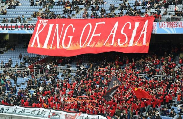 Supporters of Guangzhou Evergrande pictured in 2015 before a third-place Club World Cup match against Sanfreece Hiroshima