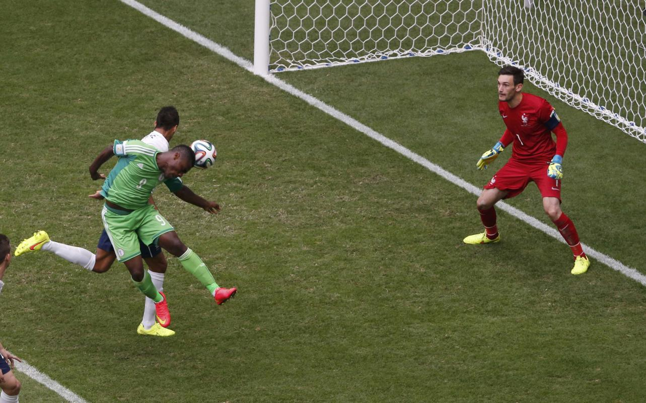 Nigeria's Emenike attempts to score a header against France's goalkeeper Lloris next to France's Varane during their 2014 World Cup round ...
