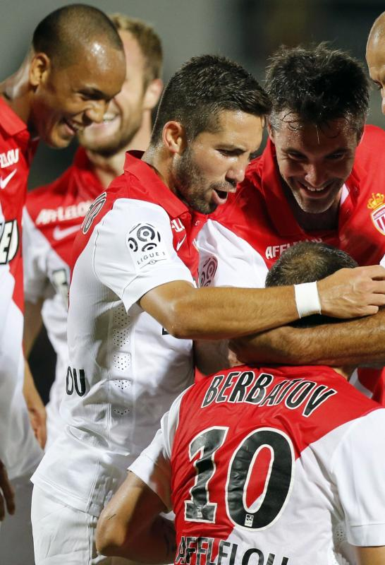 Monaco's Dimitar Berbatov celebrates with his team mates after scoring against Girondins Bordeaux, during their French Ligue 1 soccer match at the...
