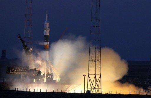 The Soyuz-FG rocket booster with Soyuz TMA-07M spacecraft blasts off from the Baikonur cosmodrome in Kazakhstan on December 19, 2012. A Russian Soyuz capsule with a three-man international crew docked without a hitch to the International Space Station on Friday after spending two days in orbit, Russian space control said.