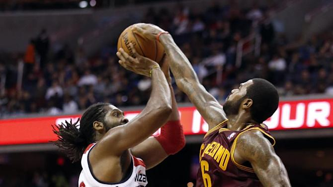 Washington Wizards forward Nene (42), from Brazil, has his shot blocked by Cleveland Cavaliers forward Earl Clark (6) in the second period of an NBA basketball game on Saturday, Nov. 16, 2013, in Washington. The Cavaliers won 103-96 in overtime