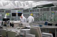 The control room at TEPCO's Fukushima nuclear power plant at Okuma town in Fukushima prefecture is shown in March 2011. The operator of Japan's crippled Fukushima nuclear power plant said that it lost $3.68 billion in the latest quarter amid massive costs stemming from last year's atomic crisis
