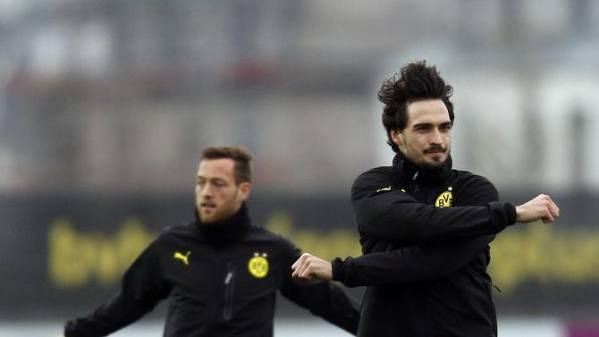 Borussia Dortmund's Hummels and Schieber warm up during a training session in Dortmund