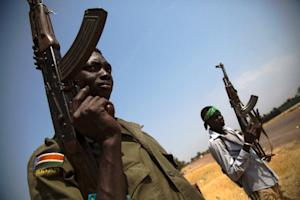 Members of the South Sudanese army (SPLA) patrol the…