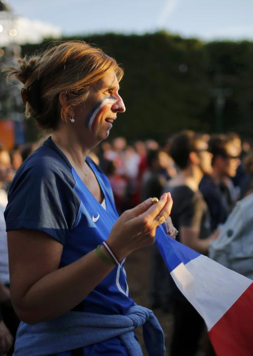 A France fan reacts in the fan zone as they watch the EURO 2016 match in Paris