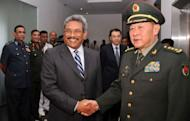 Chinese Defence Minister Liang Guanglie (right) shakes hands with Sri Lankan Defence Secretary Gotabhaya Rajapakse in Colombo on August 31. Liang is due to start a four-day visit to India with concerns over competing influence across South Asia likely to be high on the agenda