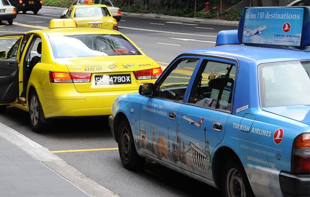 Why is it always more difficult to flag down taxis on rainy days? One study yields interesting findings. (Yahoo! file photo)