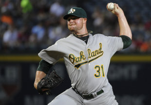 Jon Lester has been strong, but the A's have missed Yoenis Cespedes' bat. (AP)