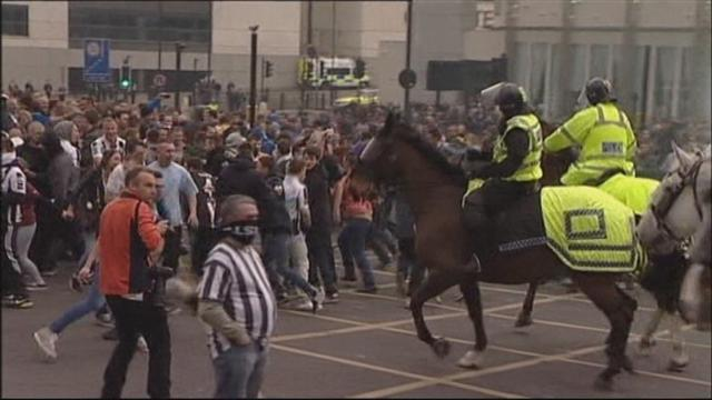 Football - Dozens held over derby game trouble