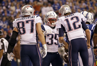Jonas Gray, center, celebrates a first-half TD with Tom Brady and Rob Gronkowski. (AP)