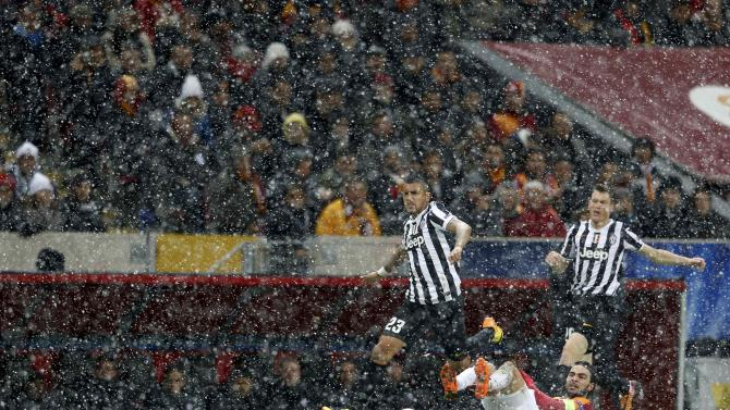 Arturo Vidal of Juventus (L) runs for the ball past Selcuk Inan of Galatasaray (bottom) before Tuesday's meeting of the two teams was postponed after 31 minutes.