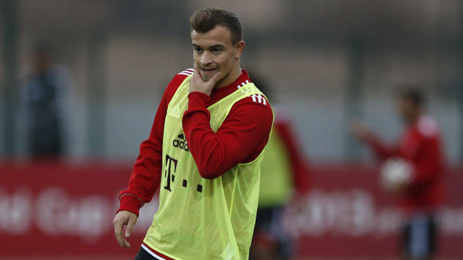 Bayern's Xherdan Shaqiri of Switzerland watches his team mates during a last training session at the Club World Cup soccer tournament in Agadir, Morocco, Monday, Dec. 16, 2013. Bayern Munich will face Guangzhou Evergrande in the first semi final on Tuesday, Dec 17