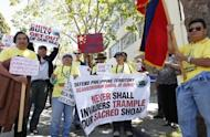 "Protesters outside the Consulate General of China in San Francisco in May oppose a territorial dispute over the Scarborough Shoal, an outcrop in the South China Sea about 230 km from the Philippines' main island of Luzon. China's official Xinhua news agency on Saturday accused US Secretary of State Hillary Clinton of ""meddling"" in the South China Sea territorial disputes"