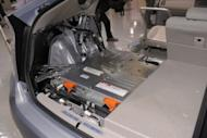 """This file photo shows a lithium-ion battery, installed under the trunk space of a Toyota Motors' Prius plug-in hybrid vehicle cut-model during a in Tokyo, in 2009. Toyota is expanding a tie-up with Germany's BMW on hybrid and fuel-cell vehicle technology as the global automakers push further into the """"green"""" market, a report said on Monday"""