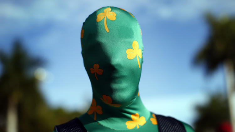Adam Soisson, a freshman at Notre Dame University, stands dressed in a costume outside Sun Life stadium before the BCS National Championship college football game between the Alabama Crimson Tide and the Notre Dame Fighting Irish in Miami