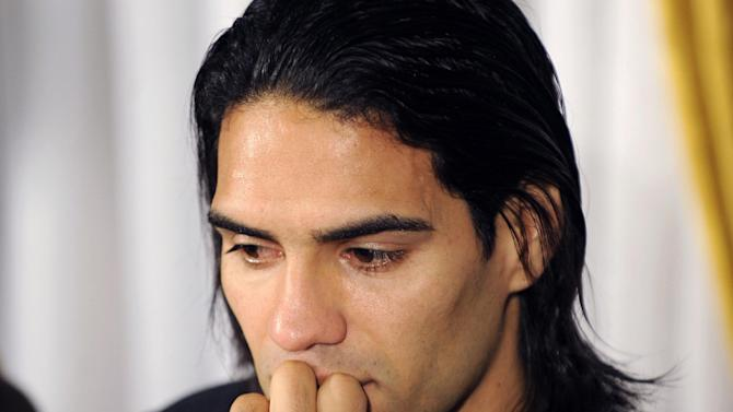 Colombian soccer star Radamel Falcao attends a press conference at the Trindade Hospital in Porto, Portugal, Monday, Jan. 27, 2014. Colombia and Monaco's striker Falcao is in a race against time to get fit for the World Cup in June after undergoing knee surgery Saturday, Jan. 25, with his doctor giving him a better than 50-50 chance of making it