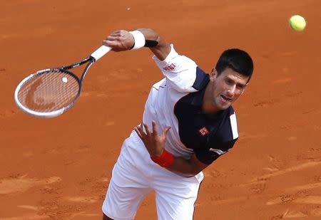 Novak Djokovic of Serbia serves to Albert Montanes of Spain during the Monte Carlo Masters in Monaco