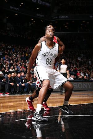 Nets rout Bulls as Collins makes home debut