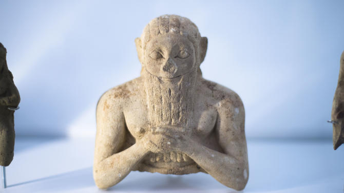 "The upper part of a male foundation figure, 3000 - 2400 BC is displayed at the exhibition ""Uruk  5,000 Years of the Megacity"" at the Pergamon Museum Berlin, Wednesday, April 24, 2013. Berlin's Pergamon Museum is offering visitors a glimpse of perhaps the world's first real metropolis in a new exhibition that traces the long history of Uruk, in present-day Iraq. The show marks a century of excavations at Uruk. But even now, organizers say that only about 4.5 percent of the sprawling site in the Iraqi desert has been explored. (AP Photo/Markus Schreiber)"