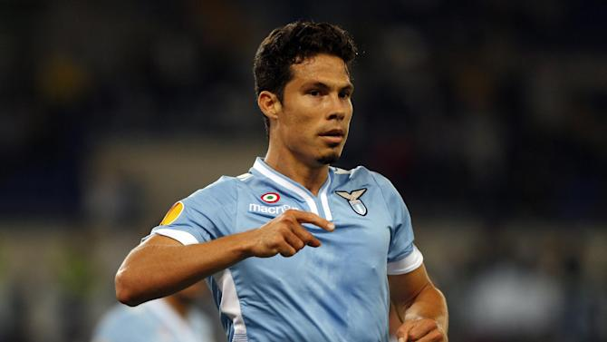 Lazio midfielder Andreson Hernanes of Brazil celebrates after scoring during an Europa League, Group J, first leg, soccer match between Lazio and Legia Warsaw, in Rome's Olympic Stadium, Thursday, Sept. 19, 2013