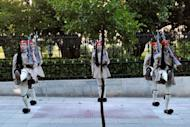 Presidental guards perform during a changing of the guard ceremony outside the presidental palace in Athens. Greece named a new cabinet to end two months of political deadlock on Thursday and said it would aim to revise the terms of an unpopular EU-IMF bailout deal without risking its eurozone membership