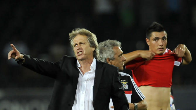 Benfica's coach Jorge Jesus points towards the fans on the stands after their victory over Vitoria Guimaraes in a Portuguese League soccer match at D. Afonso Henrique stadium in Guimaraes, Portugal, Sunday, Sept. 22, 2013. Oscar Cardozo, from Paraguay, right, scored the only goal in Benfica's 1-0 victory
