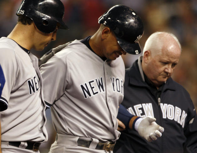 New York Yankees' Alex Rodriguez, center, is escorted by teammate Mark Teixeira, left, and an unidentified person, right, as he leaves the game in the eighth inning after being hit by a pitch during a