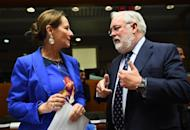French Environment Minister Segolene Royal (L) speaks with European Commissioner for Climate Action and Energy Miguel Arias Canete at the European Council headquarters in Brussels, on March 6, 2015