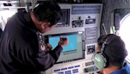 Malaysian Maritime Enforcement personnel use radar to scan for the missing Boeing 777-200 as they fly over the waters off the northeastern coast of the Malaysian peninsula, on March 9, 2014