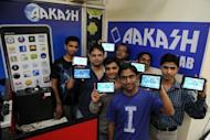 Software engineers pose with the Aakash 2 computing tablets in their lab at the Indian Institute of Technology campus in Mumbai. The Aakash tablet has been developed as a public-private partnership aimed at making computing technology available to students
