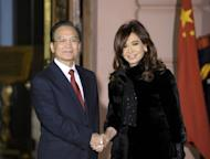 China's Prime Minister Wen Jiabao (L) and Argentine President Cristina Fernandez de Kirchner shake hands before a welcome ceremony at the Government Palace in Buenos Aires, on June 24. Wen arrived in Argentina on Saturday on an official visit aimed at boosting trade with one of South America's top agricultural producers