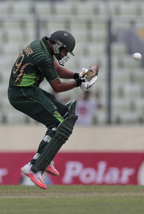 Pakistan's captain Azhar Ali avoids a bouncer during the second one-day international cricket match against Bangladesh in Dhaka, Bangladesh, Sunday, April 19, 2015. (AP Photo/ A.M. Ahad)
