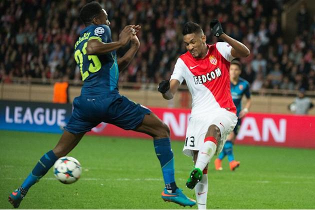 Monaco's Brazilian defender Wallace (right) kicks the ball in front of Arsenal's English striker Danny Welbeck during the UEFA Champions League match at Louis II stadium in Monaco on March 17,