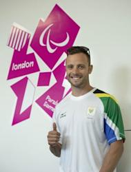 South Africa's double amputee runner Oscar Pistorius poses during a press conference ahead of the London 2012 Paralympic Games in the Olympic park in east London