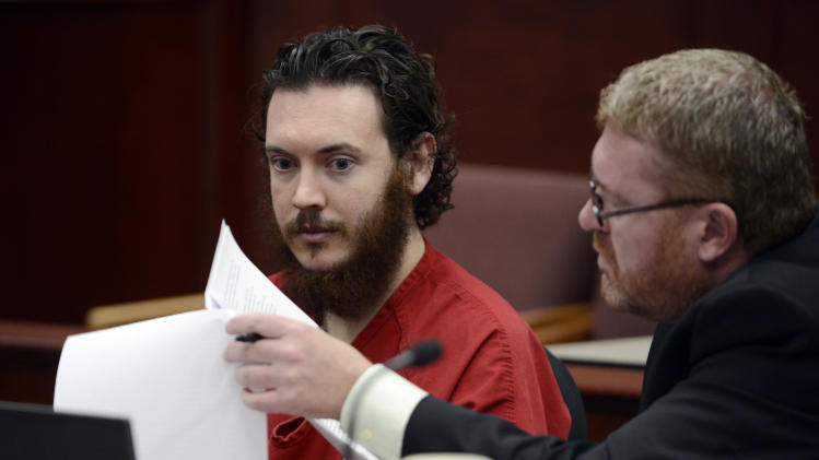 Defense Attorney Daniel King, right, and  Aurora theater shooting suspect James Holmes review advisement documents in court in Centennial, Colo., on Tuesday, June 4, 2013. Holmes was allowed to change his plea to not guilty by reason of insanity. (AP Photo/The Denver Post, Andy Cross, Pool)