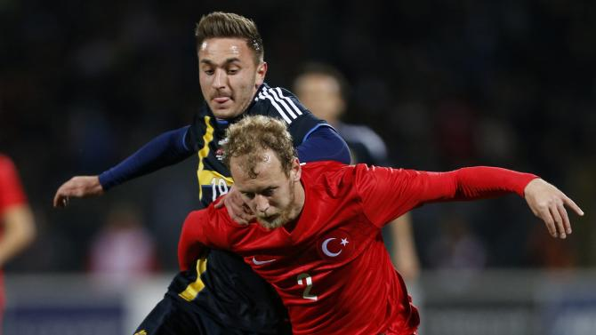 Sweden's Muamer Tankovic fights for the ball with Turkey's Semih Kaya during their international friendly soccer match at 19 Mayis Stadium in Ankara