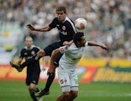 Moenchengladbach's Venezuelan midfielder Juan Arango (R) and Frankfurt's defender Sebastian Jung vie for the ball during the German first division Bundesliga football match. Second-place Frankfurt suffered their first Bundesliga defeat after going down to a shock 2-0 loss